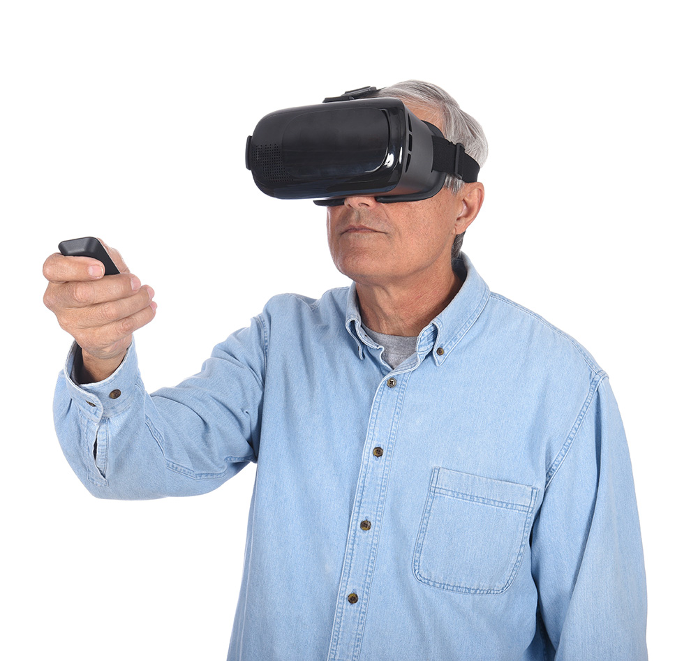 A middle aged man experiencing virtual reality goggles for the first time, isolated over white.